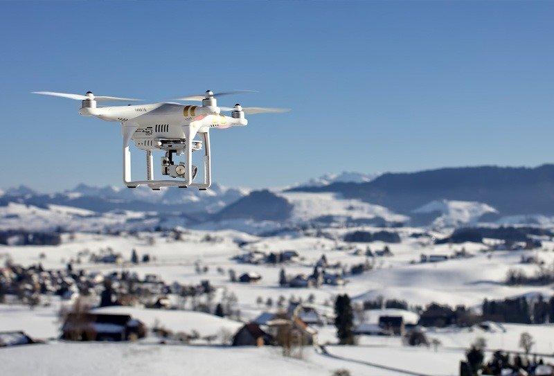 viajar com drone no inverno neve