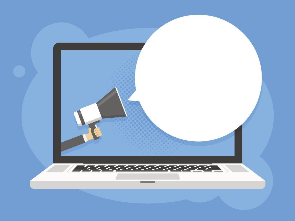 Ilustração de um notebook com um megafone. Representa o poder de comunicação ao transformar perfil em página no Facebook