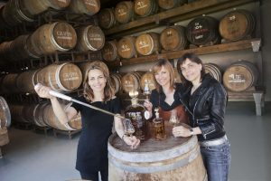 Cristina, Antonella and Elisabetta with Grappa Riserva AnticaCuvee Aged 5 Years in one of the 7 Nonino Ageing Cellars